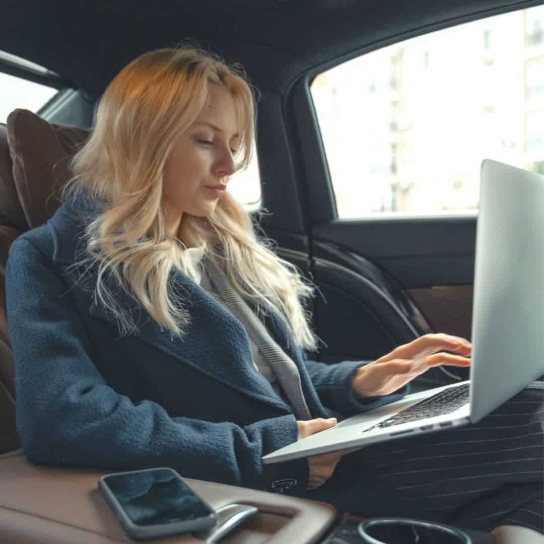 Woman on computer in car reviewing search intent